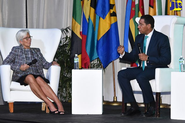 Prime Minister, the Most Hon. Andrew Holness (right), responds to a question from International Monetary Fund (IMF) Managing Director, Christine Lagarde, during the Heads of Government panel discussion on 'Challenges and Opportunities in the Caribbean' at The Jamaica Pegasus hotel in New Kingston on Thursday, November 16. The panel discussion was one of four convened during the sixth IMF High Level Caribbean Forum, which was held at the hotel on Thursday under the theme 'Unleashing Growth and Strengthening Resilience in the Caribbean'.