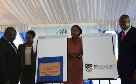 From left: Senior Director Workforce Development and Employment at HEART, Denworth Finnikin; Regional Director in the Ministry of Education Region 3, Maxine Headlam; Custos of St. Ann, Hon. Norma Walters; and Executive Director, HEART Trust/NTA, Dr. Wayne Wesley, look at the plaque and new logo of the HEART College of Hospitality Services. Occasion was the official renaming ceremony of the Runaway Bay HEART Hotel and Training Institute, held on Thursday (Feb. 20) at the facility in St. Ann.