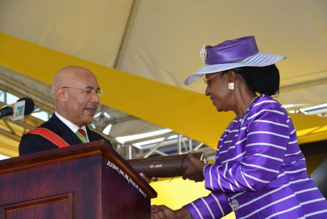 Governor General, His Excellency, the Most Hon. Sir Patrick Allen, (left) presents the Magistrates Roll to newly installed Custos of St. Ann, Hon.Norma Walters, during the official installation ceremony held at the Seville Heritage Park, St. Ann's Bay on Thursday, March 13.