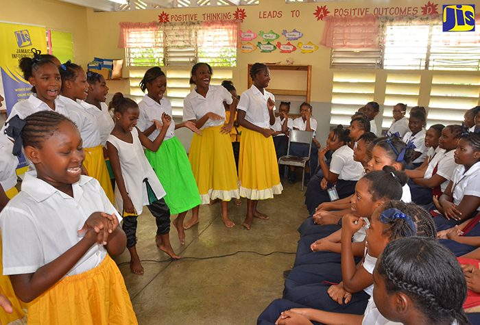 Students of Half-Way Tree Primary School in St. Andrew perform a cultural item during the Jamaica Information Service's (JIS) Heritage Month School tour on Tuesday (October 11). More than 20 early-childhood, primary and secondary institutions will receive donations of educational material produced by the agency during the school visits.