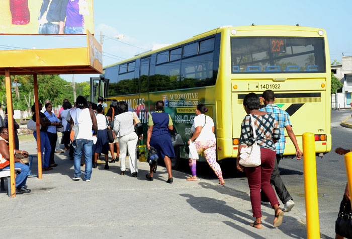 Commuters boarding  a JUTC bus which plies the Spanish Town to Half-Way Tree route.