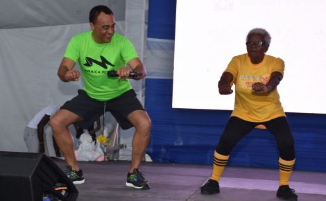 Minister of Health, Dr. the Hon. Christopher Tufton (left), tries to outdo senior citizen Gwendolyn Morgan from the Comprehensive Health Centre's exercise group, at Jamaica Moves' first anniversary celebration held at Emancipation Park on Friday (April 13).