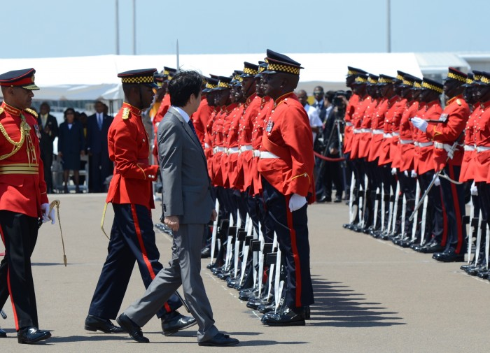 Prime Minister of Japan, His Excellency Mr. Shinzo Abe (3rd left), inspects the Guard of Honour mounted by the Jamaica Defence Force (JDF), when he arrived at the Norman Manley International Airport, today (September 30), for a two-day official visit to the island.