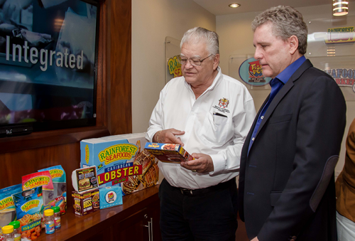 Industry, Commerce, Agriculture and Fisheries Minister, Hon. Karl Samuda (left), and Chief Executive Officer of Rainforest Seafoods, Brian Jardim, peruse a package of fish nuggets during a tour of the entity's plant on Slipe Road in Kingston, on Friday, May 6.