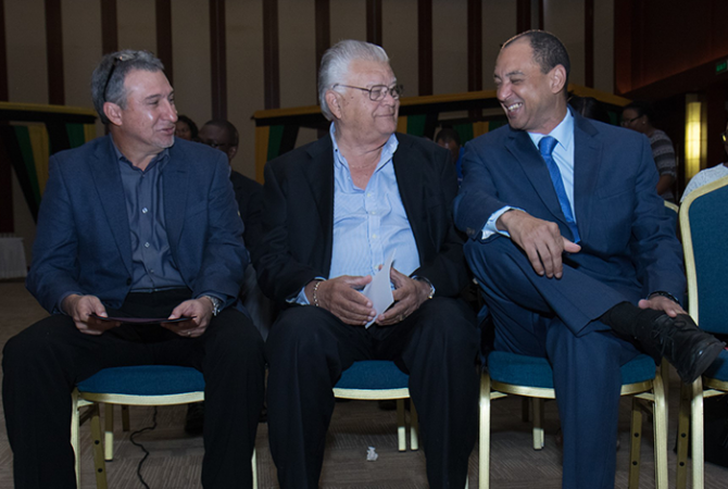 Minister of Industry, Commerce, Agriculture and Fisheries, Hon. Karl Samuda (centre), is in light conversation with Chairman of JAMPRO, Senator Don Wehby (right) and President of the Jamaica Manufacturers' Association (JMA) Metry Seaga. Occasion was the press launch of the inaugural Jamaica International Exhibition (JMA) trade show at the Montego Bay Convention Centre in Rose Hall, St. James on January 11. The event, organised by the JMA, will be held at the Convention Centre from June 1-4.