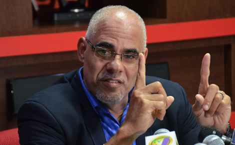 Economic Programme Oversight Committee (EPOC) Co-Chairman, Keith Duncan, addressing journalists during EPOC's quarterly media briefing at the Jamaica Money Market Brokers (JMMB) Group's head office in New Kingston on Friday, May 19.