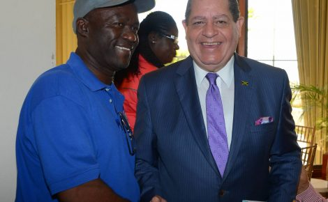 Minister of Finance and the Public Service, Hon. Audley Shaw (right), exchanges a warm handshake with President of the Small Business Association of Jamaica, Hugh Johnson, after addressing the Jamaica National (JN) Small Business Loans Limited luncheon held on Friday (December 9), at the Jamaica Conference Centre, downtown Kingston.