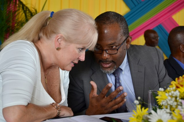 Minister of State for Agriculture, Labour and Social Security. Hon Luther Buchanan (right), converses with Mission Director, United States Agency for International Development (USAID),  Denise Herbol, during a graduation ceremony at the Girl Guides Association headquarters in Kingston, today (February  5). During the ceremony,  186 persons graduated from the Jamaica Rural Economy and Ecosystems Adapting to Climate Change (Ja REEACH) project's climate-smart agriculture farmer field school and climate change action training programme.