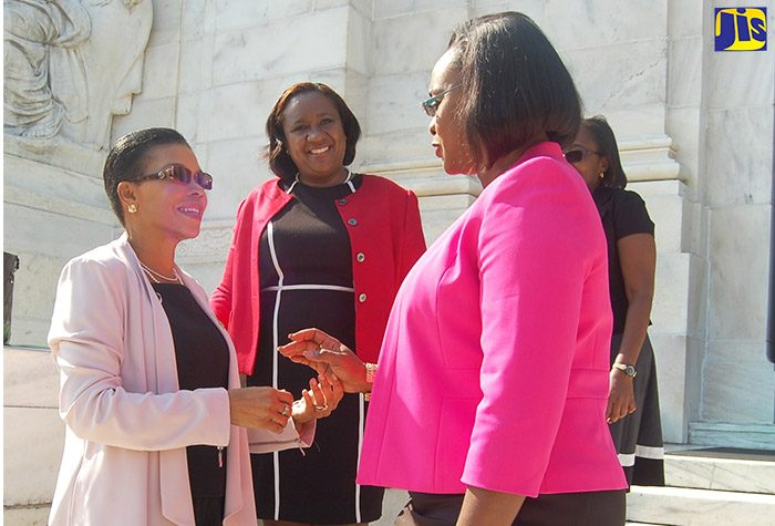 Member of Parliament for East Rural St. Andrew,  and wife of Prime Minister, the Most Hon. Andrew Holness, Mrs.  Juliet Holness, converses with Jamaica's Ambassador to the United States, Her Excellency Audrey Marks, just before the start of the Caribbean Regional Workshop for Parliamentarians and Policymakers on Cybersecurity, held at the Organization of American States headquarters in Washington, DC.  Mrs. Holness was among several parliamentarians from the Caribbean region who participated in the workshop held from October 17 to 20.  Looking on at centre is the Deputy Chief of Mission, Embassy of Jamaica in Washington, Marsha Coore-Lobban.