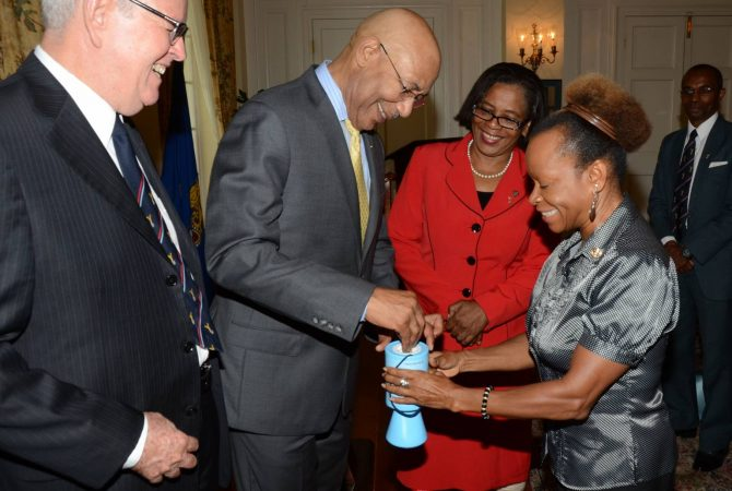 Governor-General, His Excellency, the Most Hon. Sir Patrick Allen (2nd right), makes his contribution to the Royal Air Forces Association (RAFA) Jamaica Wings Appeal, at the launch of the fundraising campaign on March 23 at King's House. Looking on (from left) are: President of the RAFA Jamaica, Major General Robert Neish; Chairman of RAFA Jamaica, Major (retired) Joanna Lewin; and Honorary Secretary, RAFA Jamaica, Valrie Tate. In background is Vice President of RAFA Jamaica, Brigadier Rocky Meade.