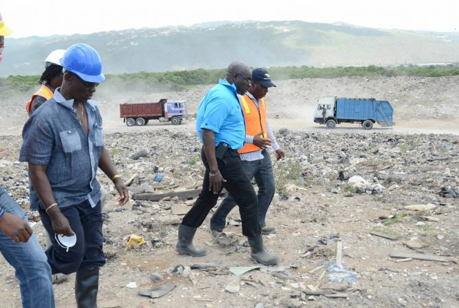 Local Government and Community Development Minister, Hon. Desmond McKenzie (left), is accompanied by National Solid Waste Management Authority (NSWMA) Executive Director, Colonel Daniel Pryce (second left), and Regional Operations Manager, Adrian Grant (right), on a tour of the Riverton City Landfill, in Kingston, on March 24.
