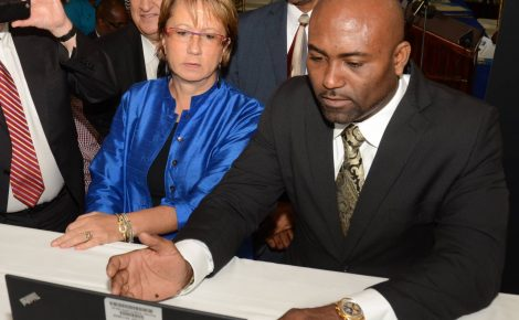Minister of Science, Energy and Technology (MSET), Dr. the Hon. Andrew Wheatley (right), uses a laptop to access the Open Data Portal at its launch on June 24, at the Petroleum Corporation of Jamaica (PCJ), in Kingston. Country Manager of the World Bank, Galina Sotirova (left), looks on. In the background (from left) are: Chief Information Officer in the Ministry, Louis Shallal and Director, Technology, Gary Campbell.