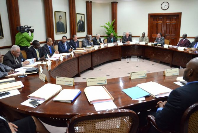 Prime Minister the Most. Hon. Andrew Holness (fifth left), addresses Members of the Cabinet at the first official meeting, today (March 15), at the Office of the Prime Minister.