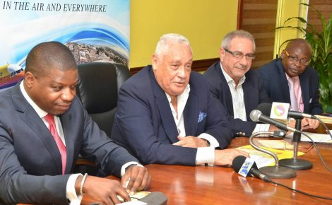Minister of Transport and Mining, Hon. Mike Henry (second left), addresses the ceremony for the signing of a Memorandum of Understanding (MOU) regarding the resuscitation of cargo and passenger rail service in Jamaica, at the Ministry's Maxfield Avenue offices in Kingston, on December 9. Others (from left) are President of Herzog International Inc, Dr. Sean Matthew; Chairman, Jamaica Railway Corporation (JRC), Ferris Ziadie; and General Manager, JRC, Fitzroy Williams.