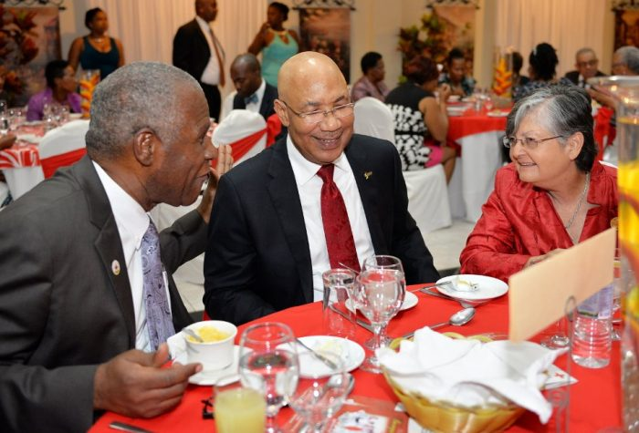 Governor-General, His Excellency, the Most Hon. Sir Patrick Allen (centre), shares a light moment with President of the Jamaica Red Cross, Dr. Dennis Edwards and Custos Rotulorum of Manchester, Hon. Sally Porteous. Occasion was the fundraiser banquet of the Mandeville Red Cross held on Saturday (May 28) at the Golf View Hotel.