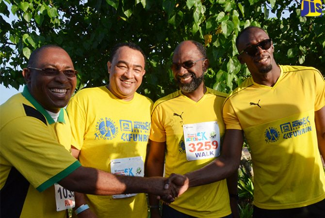 Minister of Health, Hon. Dr. Christopher Tufton (2nd left) shares a moment with from left: Mayor of Falmouth, Councillor Garth Wilkinson, Chairman of the Jamaica National Foundation and General Manager of Jamaica National Building Society, Earl Jarrett and Olympic and world sprint record holder, Usain Bolt shortly before the start of the Heroes In Action Run/walk in Falmouth, Trelawny on Sunday, October 16. The event served as a fundraiser for charities in western Jamaica.