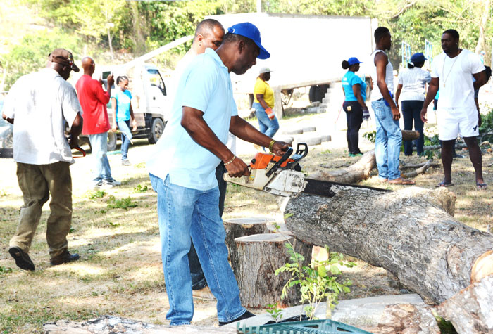 Mayor of Montego Bay, Councillor Glendon Harris, participates in work at the Cornwall Court Kiddies Park, which was the St. James parish project for Labour Day.