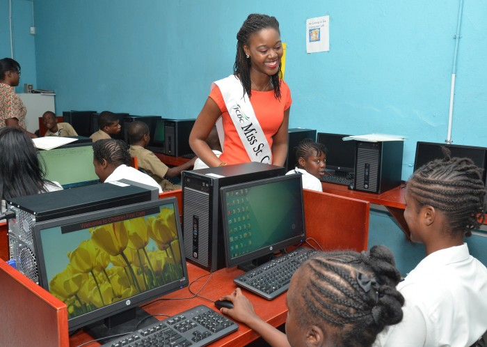 Miss St. Catherine Festival Queen 2014, Danene Cruickshank, speaks to students at the Children's First Achievement Centre in Spanish Town, after  the launch of a  Literacy project at the centre today (Jan 14).