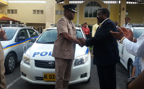 Minister of National Security, Hon. Robert Montague (right), presents the keys to one of four preowned cars to Superintendent Wayne Cameron of the Mandeville Police Station at the Golf View Hotel in Mandeville on July 6. The Minister also addressed the Manchester Chamber of Commerce meeting at the same venue.
