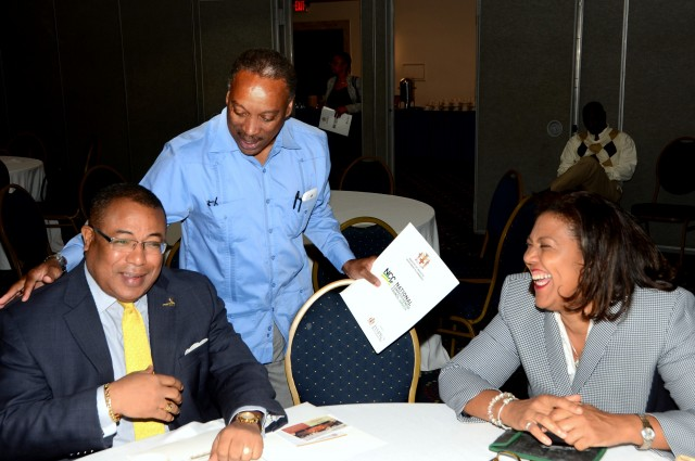 Minister of Industry, Investment and Commerce, Hon. Anthony Hylton (left) , enjoys a light moment with Chairman, Jamaica Promotions Corporation (JAMPRO), Milton Samuda (centre); and Executive Director (Acting)/Legal Counsel, Jamaica Intellectual Property Office, Lilyclaire Ballamy. Occasion was the National Competiveness Council's 5th annual business environment reform roundtable at the Jamaica Pegasus Hotel in New Kingston today (Feb. 26). The roundtable meeting was aimed at promoting collaboration between the private and public sectors to improve the ease of doing business in Jamaica.