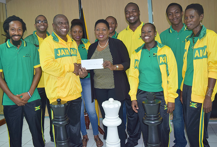 Sports Minister, Honourable Oliva 'Babsy' Grange presents President of the Jamaica Chess Federation, Ian Wilkinson with a cheque during a Courtesy Call paid on the Minister at the Ministry of Culture, Gender, Entertainment and Sport on Thursday, August 25, 2016. The two were joined by members of the team that will represent Jamaica at the 2016 Chess Olympiad in Baku, Azerbaijani, September 1-14.