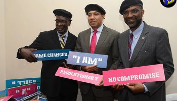Prime Minister, the Most Hon. Andrew Holness (centre) and Education, Youth and Information Minister, Senator the Hon. Ruel Reid (left), show their support for the Jamaica National (JN) Foundation's education revolution at the entity's Leadership Summit, held at The Jamaica Pegasus hotel in New Kingston on July 25. At right is JN Foundation Chairman, Earl Jarrett.
