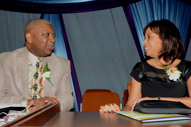 Minister of State in the Ministry of Industry, Investment and Commerce, Hon. Sharon Ffolkes-Abrahams (right), having a light exchange with Dean and Associate Professor in the College of Business and Management at the University of Technology (UTech), Dr. Paul Golding, at the opening of the 20th Annual Students' Conference, hosted by UTech at the Jamaica Conference Centre,  Downtown Kingston, on March 24.