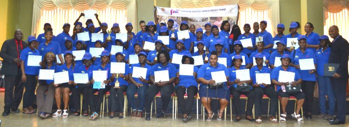 The 55 newly certified Environmental Wardens, under the Jamaica Social Investment Fund's (JSIF) Integrated Community Development Project (ICDP), show off their certificates at the graduation ceremony held on October 9, at the Wexford Hotel in Montego Bay.