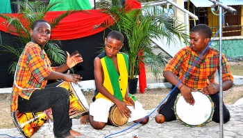 The Young Lions Drummers show off the skills that brought them gold medals in the Jamaica Cultural Development Commission's (JCDC) 2014 Festival of the Arts competition, at a civic ceremony commemorating the 127th  anniversary of the birth of  the Right Excellent Marcus Mosiah Garvey, held on August 17 at Lawrence Park  in St. Ann.
