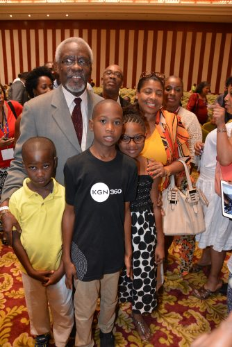 Former Prime Minister, the Most Hon. P. J. Patterson (2nd left), interacts with children attending the closing ceremony of the 6th Biennial Jamaica Diaspora Conference on Wednesday (June 17), at the Montego Bay Convention Centre in St. James. Mr. Patterson delivered the main address at the ceremony.