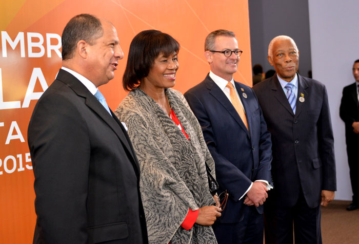 Prime Minister Portia Simpson Miller (2nd left) arrives for the opening of the two-day third Summit of Heads of Government of the Community of Latin America and Caribbean States (CELAC) in San Jose, Costa Rica on Wednesday (January 28).  Here she is met by the President of Costa Rica, Luis Guillermo Solis Rivera (left) and Minister of Foreign Affairs of Costa Rica, Manuel Gonzales Sanz (2nd right). Minister of Foreign Affairs and Foreign Trade, A.J. Nicholson (at right) accompanied the Prime Minister to the CELAC Summit being held January 28 and 29.