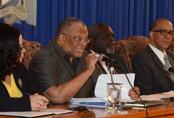 Finance and Planning Minister, Dr. the Hon. Peter Phillips (2nd left), responds to a question posed during a media briefing on Monday (January 26) at Jamaica House. Listening keenly are: Minister with Responsibility for Information, Senator the Hon. Sandrea Falconer (left); Financial Secretary, Devon Rowe (2nd right); and Bank of Jamaica (BoJ) Governor, Brian Wynter.