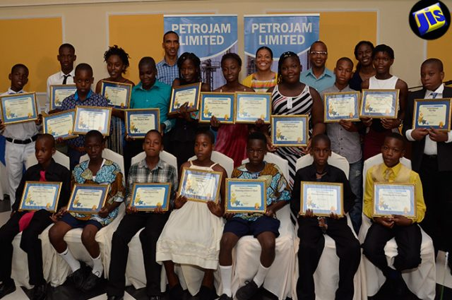 Top-performing Grade Six Achievement Test (GSAT) students from Greenwich All-Age and the St. Andrew Primary schools pose with officials at Petrojam, after they were presented with scholarships valued at $1.2 million, at a luncheon held recently at Terra Nova All-Suite Hotel in St. Andrew.