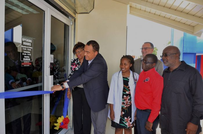 Minister of Health, Hon. Dr. Christopher Tufton (2nd left), cuts the ribbon to officially open the upgraded Drug Serv Pharmacy in Greater Portmore, St. Catherine on June 9. Looking on (from left, forefront)) are: Parish Manager, St. Catherine Health Services, Beverly Needham; Acting Pharmacy Manager, Tina Page; Chief Executive Officer, National Health Fund (NHF), Everton Anderson; and Member of Parliament for South St. Catherine, Fitz Jackson. In the background is Chairman of the NHF, Gregory Mair.