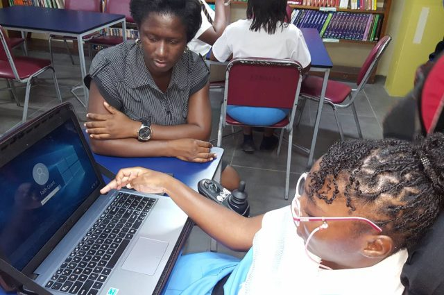 Ardenne High School student, Faith Grant (right), logs in to Skype ahead of an Electronic Document Processing and Management (EDPM) class at the institution, while a member of the academic staff, assisting her, looks on.