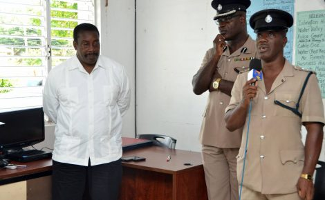 Minister of National Security, Hon. Robert Montague (left), listens while Commanding Officer for St. Mary, Deputy Superintendent (DSP), Dwight Powell (right), addresses the handing over ceremony for a closed-circuit television (CCTV) at the Islington Police Station, in the parish, on December 7. At centre is Assistant Commissioner of Police(ACP), Fitz Bailey.