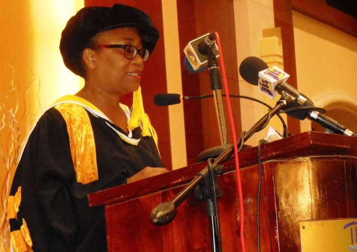 Interim President of Mico University College, Professor Carol Clarke, addresses the graduation ceremony for Master of Science degree students from Mico, and the Sam Sharpe and Moneague teachers' colleges, held on Sunday (January 11), at the Montego Bay Convention Centre in St. James.