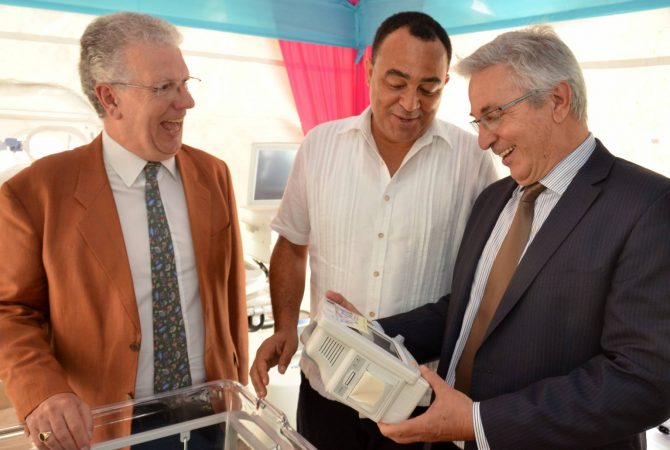 Health Minister, Dr. the Hon. Christopher Tufton (centre), examines equipment handed over to the Mandeville Regional Hospital under the Programme for the Reduction of Maternal and Child Mortality (PROMAC), on June 24. Others (from left) are: French Ambassador to Jamaica, Jean-Michel Despax and Chargé d'Affaires of the European Union Delegation, José Luis Martinez Prada.