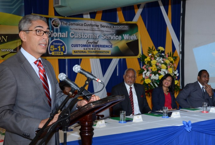 President and Chief Executive Officer, Sagicor Group Jamaica Limited, Richard Byles (at podium), addressing the recent launch of the 2014/15 Public Sector Customer Service Competition, being staged by the Office of the Cabinet, at the Ministry of Finance and Planning in Kingston. Listening keenly at the head table are: Cabinet Secretary, Ambassador Douglas Saunders; Chairperson, Jamaica Customer Service Association (JaCSA), Lanie Oakley-Williams (right); and President, Jamaica Civil Service Association (JCSA) President, O'Neil Grant.