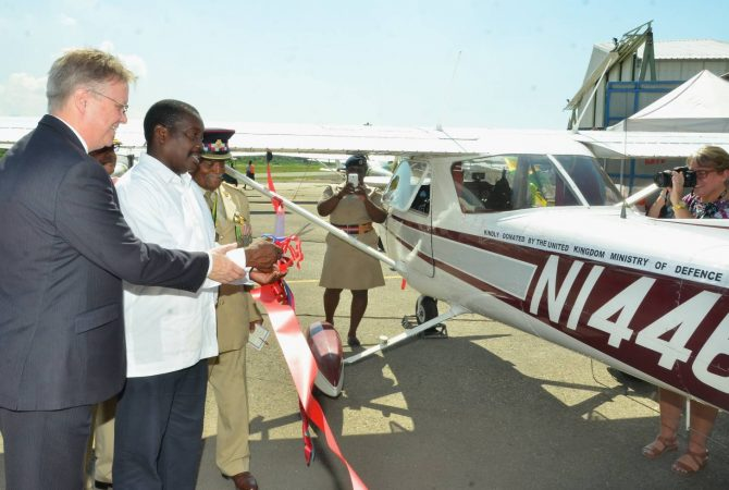 National Security Minister, Hon. Robert Montague (2nd left), is assisted by British High Commissioner to Jamaica, His Excellency David Fitton (left); and senior Jamaica Combined Cadet Force (JCCF) officer, Lieutenant Colonel Victor Beek, to commission a Cessna airplane at the Caribbean Aviation Training Centre at Tinson Pen Aerodrome in Kingston on Friday, September 23. The aircraft, donated by the British Government, will be used in the JCCF's aviation training programme.