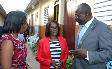 Education, Youth and Information Minister, Senator the Hon. Ruel Reid, speaks with Principal of the Sligoville All-age School, Kareen Watson (centre); and Board Chairman, Gloria Browns-Mills, just before the start of the 175th anniversary celebration dinner at the institution in St. Catherine on May 19.
