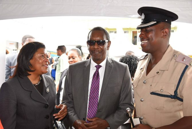 Chief Justice, Hon. Zaila McCalla (left), in discussion with (from second left) President of the Court of Appeal, Hon. Justice Dennis Morrison; and Superintendent of Police, Manchester Division, Wayne Cameron, during a tour of exhibitions at a Public Education Day at the Manchester Parish Court on October 25.