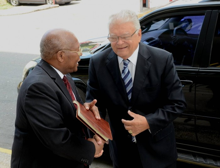 Minister of Industry, Commerce and Agriculture, Hon. Karl Samuda (right), is greeted by Permanent Secretary in the Ministry, Vivian Brown, when he arrived for the first day in office, at the Ministry's New Kingston location, on March 8.