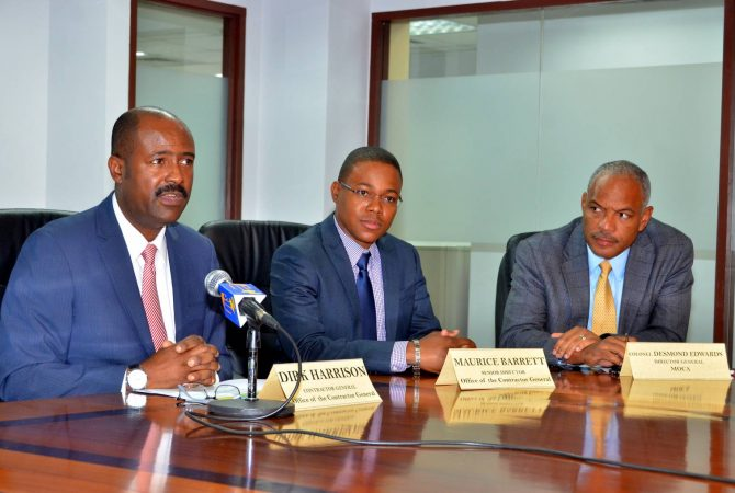 Contractor General, Dirk Harrison (left) responds to questions in an interview with JIS News on Friday (April 21), while Senior Director in the Office of the Contractor General (OCG), Maurice Barrett (centre) and Director General, Major and Organized Crime and Anti-Corruption Agency (MOCA), Colonel Desmond Edwards (right) look on. The OCG is spearheading Jamaica's staging of the Commonwealth Caribbean Association of Integrity Commissions and Anti-Corruption Bodies (CCAICACB) Conference from April 24 to 28 at the Jamaica Pegasus Hotel in Kingston. The Conference, to involve high-level local, regional and international participation, is to be held under the theme 'The Anti-Corruption Agenda – Today, Tomorrow, the Region and Beyond'.
