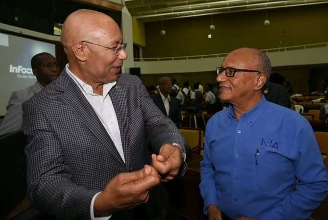 Governor-General, His Excellency the Most Hon. Sir Patrick Allen (left), in discussion with Executive Director, National Integrity Action, Professor Trevor Munroe, at the 2017 National Youth Consultative Conference at the Jamaica Conference Centre in downtown Kingston, on October 5