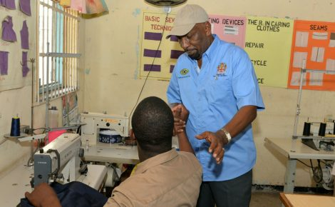 State Minister in the Ministry of National Security, Hon. Rudyard Spencer (right), interacts with a ward of the State at the Rio Cobre Juvenile Correctional Centre, in St. Catherine, during a tour on April 27.