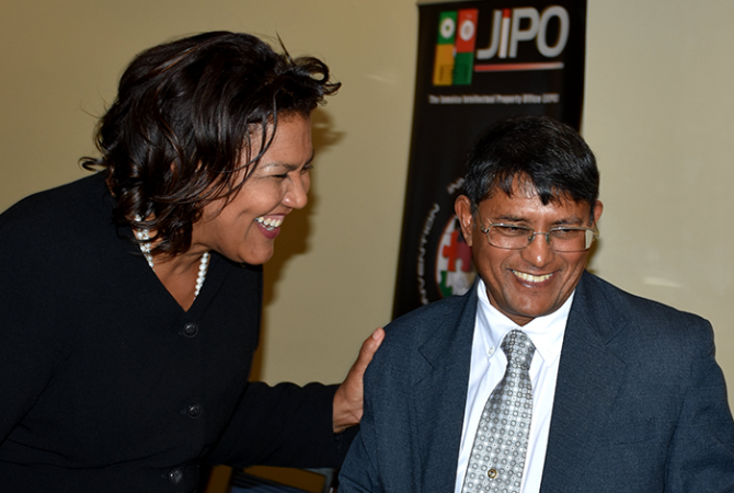Acting Permanent Secretary in the Ministry of Industry, Commerce, Agriculture and Fisheries, Reginald Budhan (right), shares a joke with Executive Director, Jamaica Intellectual Property Hub (JIPO), Nicola Wint, at the official launch of the Reach Entrepreneurial Asset Commercialization Hub (REACH) at the Courtyard by Marriot Hotel in New Kingston recently.