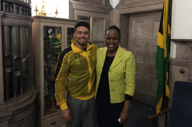 Deputy High Commissioner to London, Deidre Mills (right), shares a moment with Gymnast Reiss Beckford, during a courtesy visit at the Jamaican High Commission in London on Tuesday (November 24)