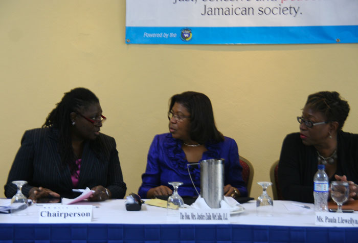 Chief Justice, Hon. Zaila McCalla (centre); and Director of Public Prosecutions (DPP), Paula Llewellyn (right), are in discussion with Acting Puisne Judge and President of the Association of Resident Magistrates, Justice Cresencia Brown, at a Restorative Justice Protocol and Case Management System Sensitization workshop held on Saturday (Nov. 9), at the Jewel Paradise Cove Beach Resort and Spa in Runaway Bay, St. Ann.