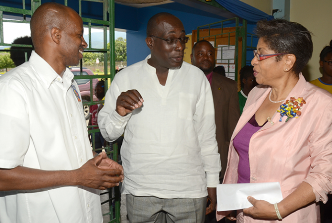 Education, Youth and Information Minister, Senator the Hon. Ruel Reid (centre), engages Kiwanis Club Lieutenant Governor, Beverley Thompson (right), in discussion during the service organization's annual Division 23 East youth rally at Ardenne High School in Kingston, on Saturday, May 7. Listening keenly is Distinguished Lieutenant Governor for Division 23, Lloyd Distant.